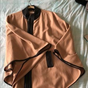 Tan poncho lined with black leather